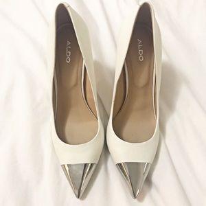 White Aldo pumps with silver toe